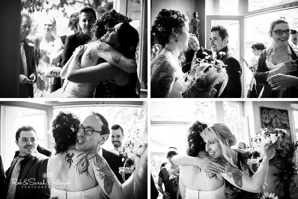 Wedding guests congratulate brides at same-sex wedding