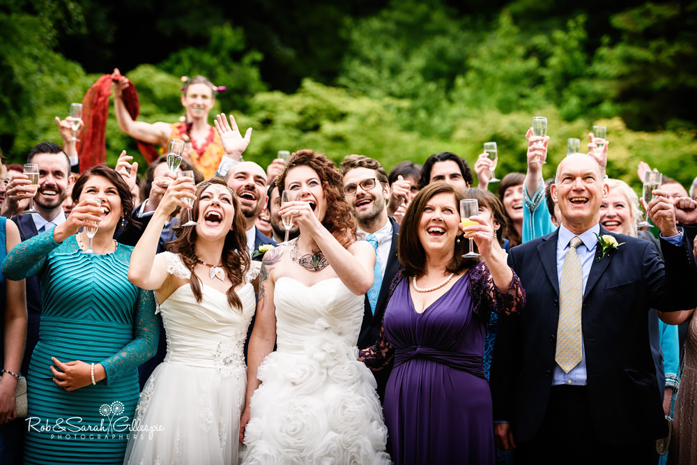 Wedding guests cheer for group photo at the Matara Centre