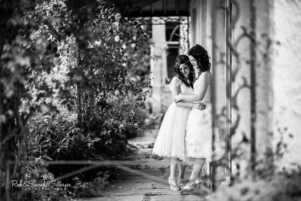 Two brides together in Matara Centre grounds at same sex wedding