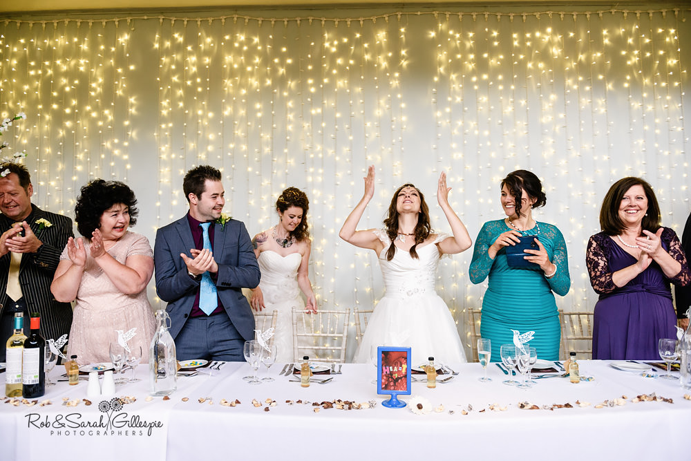 Brides make their entrance to wedding meal at Matara Centre