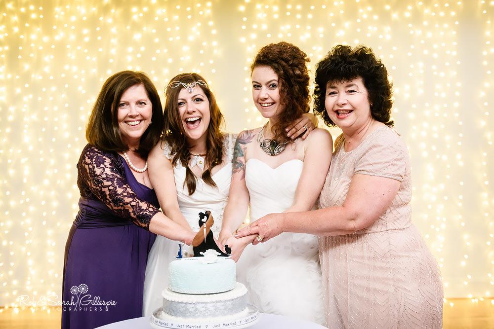 Two brides cut their wedding cake at Matara Centre same sex wedding