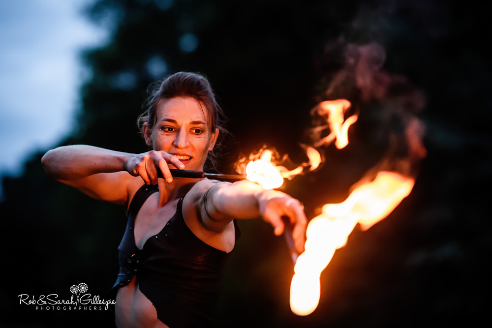 Acrobat fire performance at same sex wedding
