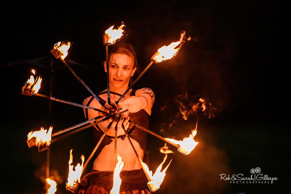 Acrobat fire performance at same-sex wedding