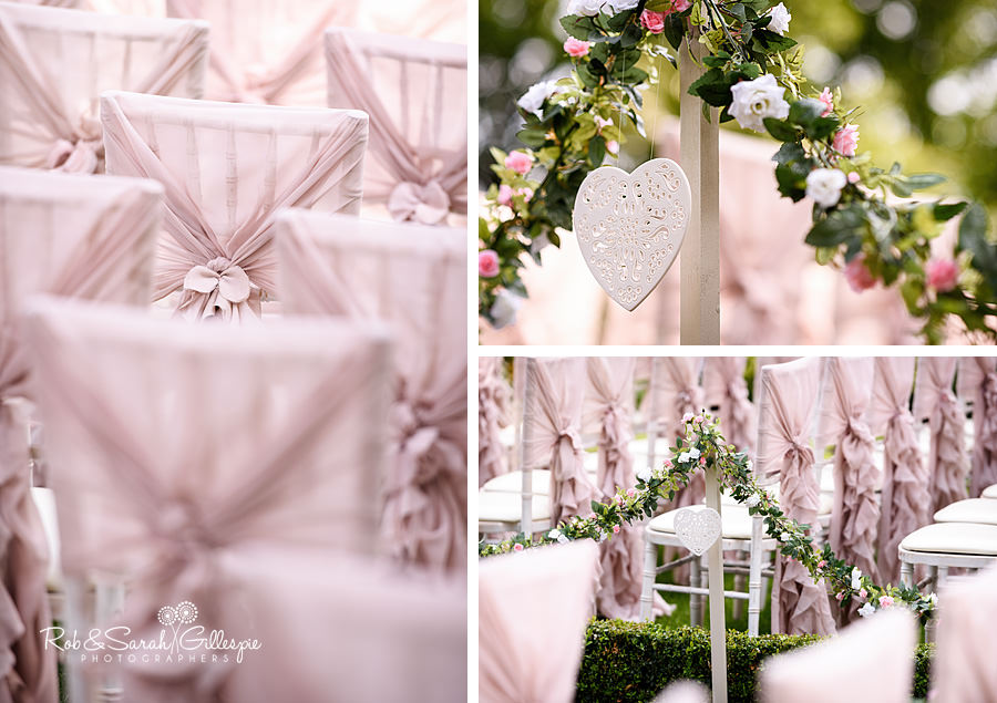 Beautiful pink chair covers and flowers at Warwick House wedding