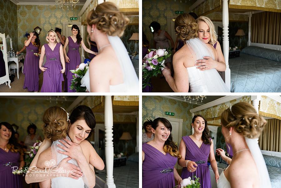 Bridesmaids see bride ready at Warwick House