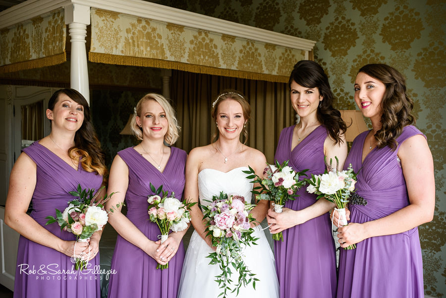 Bride and bridesmaids group photo at Warwick House