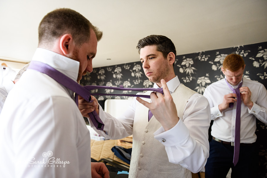 Groom and ushers get ready for wedding at Warwick House