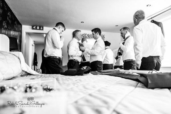 Groom prepares for wedding at Warwick House