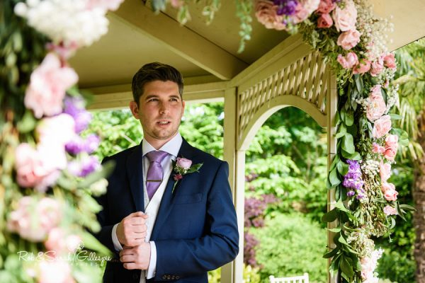 Groom waits for bride at Warwick House wedding ceremony