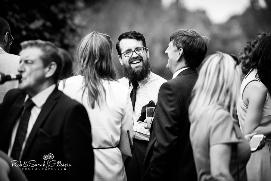 Wedding guests congratulate bride and groom at Warwick House