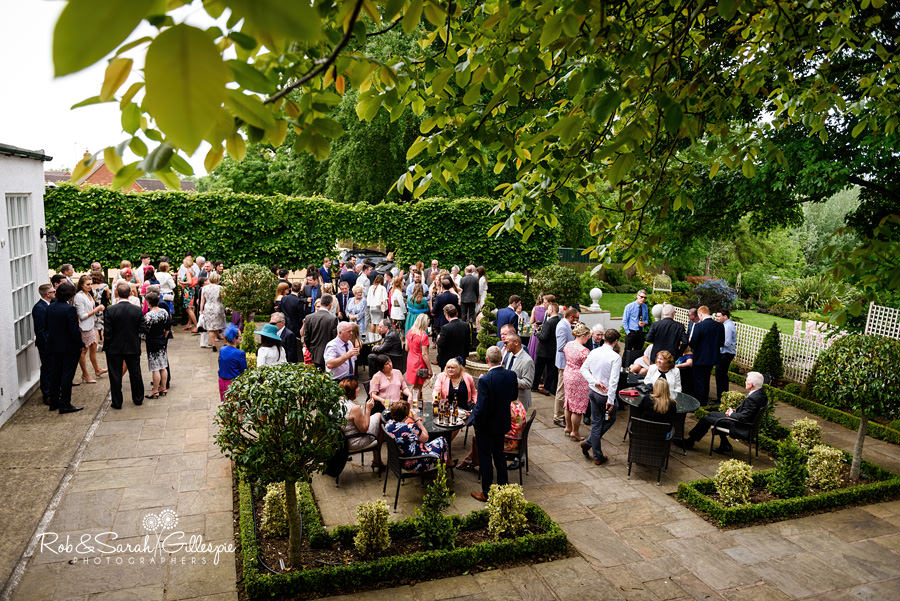 Bride and groom together outisde at Warwick House