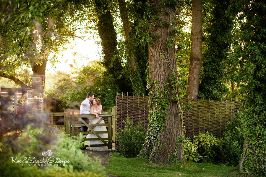 Bride and groom together in beautiful evening light at Warwick House