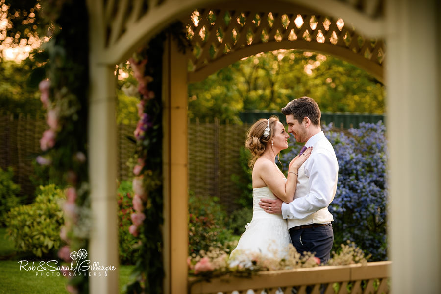 Bride and groom in gardens at Warwick House