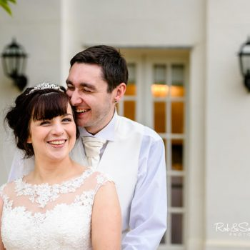 Bride and groom laughing together at Warwick House wedding venue