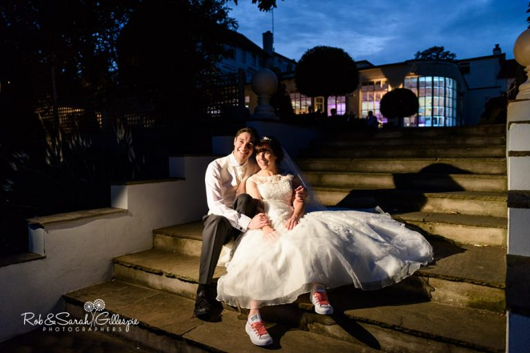 Bride and groom on steps at Warwick House
