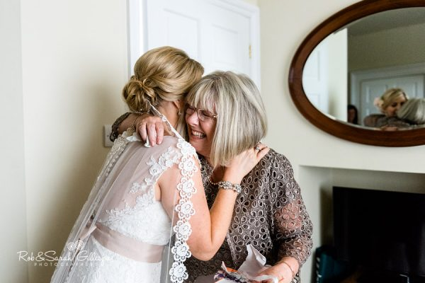 Bride and mum hug at Wethele Manor