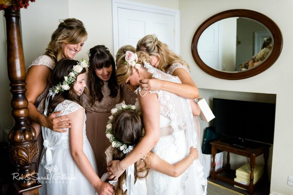 Bride and friends group hug at Wethele Manor