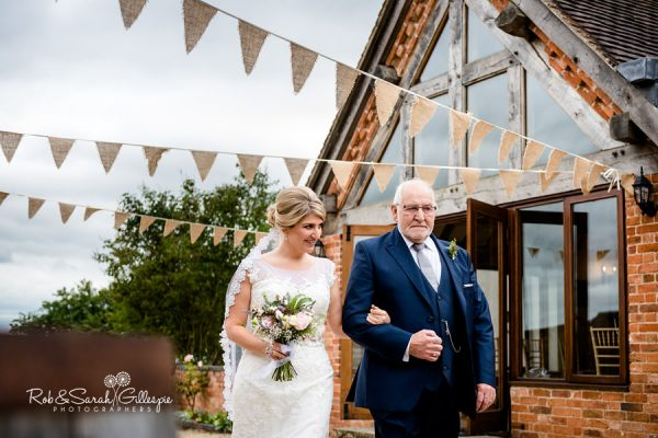 Bride and father under bunting at Wethele Manor