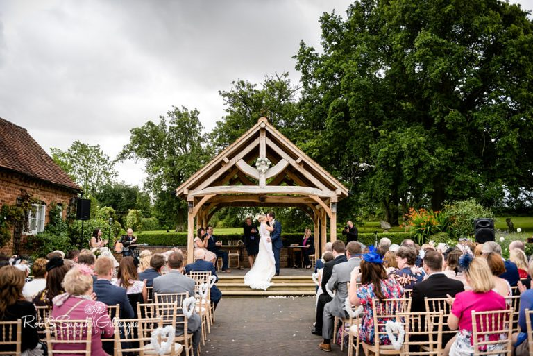 Wethele Manor outdoor wedding ceremony under Orchard Bothy