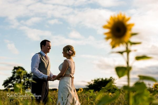 Bride and groom in sunflower field at Wethele Manor
