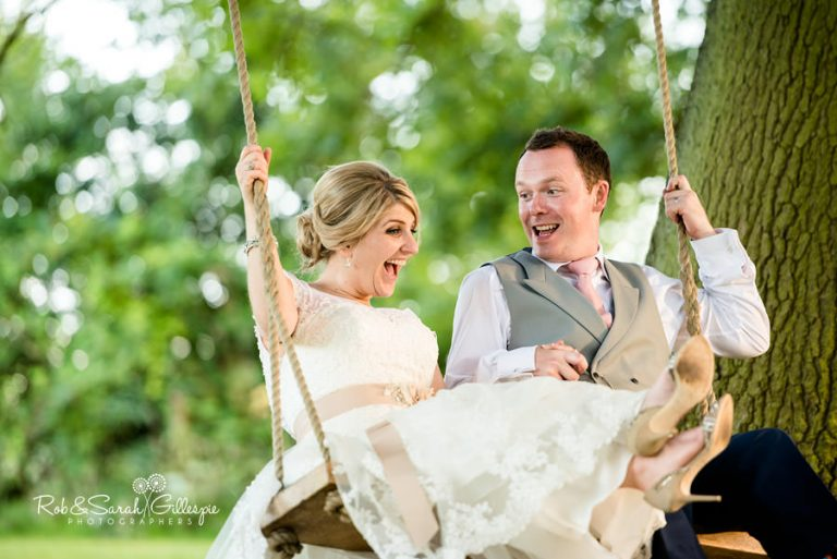 Bride and groom on swing at Wethele Manor