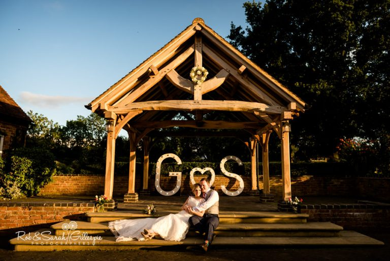 Orchard Bothy at Wethele Manor with bride and groom sitting in beautiful evening light
