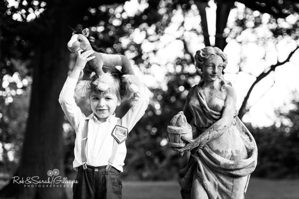 Boy playing in grounds at Wethele Manor wedding