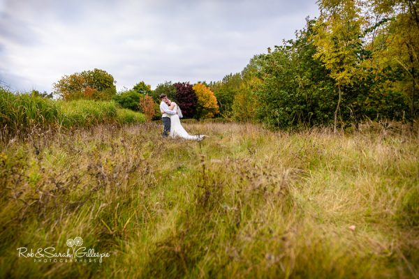 Bride and groom in Alrewas Hayes grounds