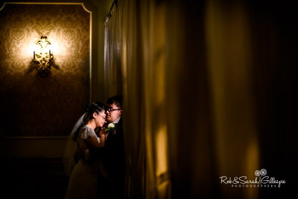 Bride and groom at Alrewas Hayes with dramatic lighting