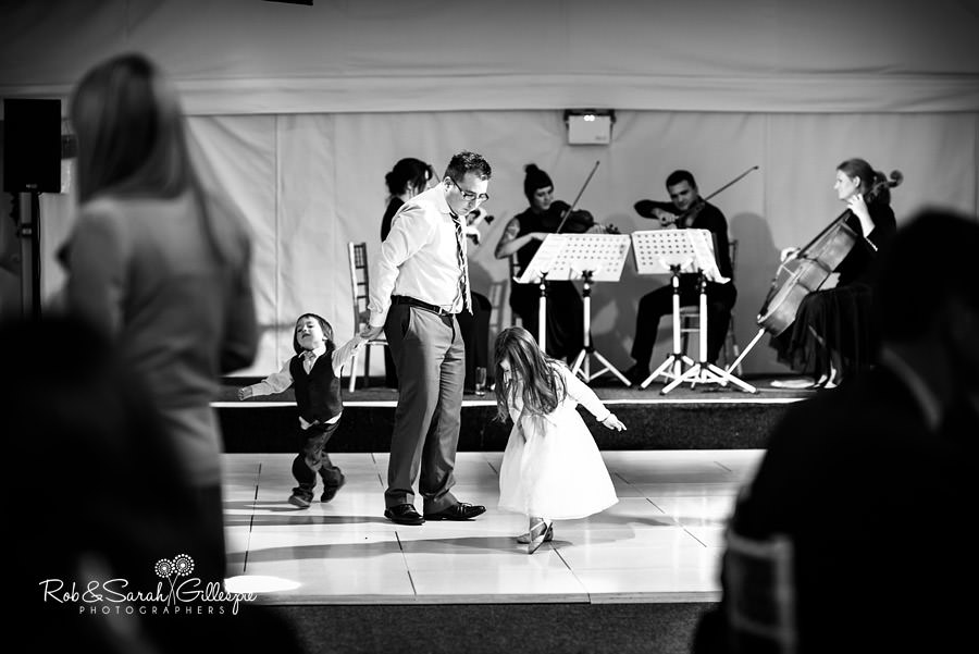 Father and children on dancefloor at Alrewas Hayes wedding.