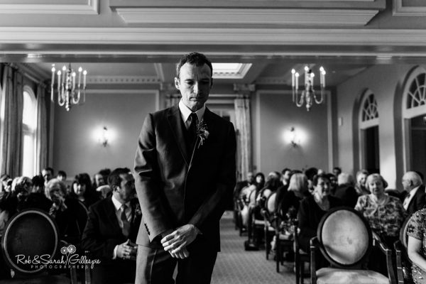 Groom waits anxiously at Brockencote Hall wedding