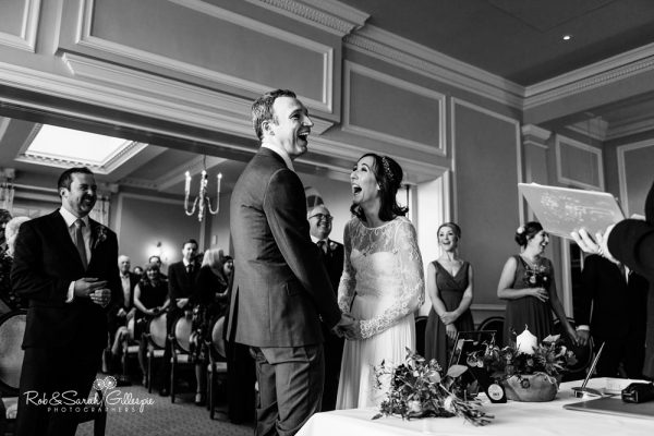 Couple laughing during civil wedding at Brockencote Hall