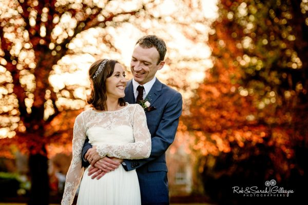 Couple in Brockencote Hall grounds in beautiful light