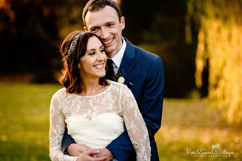 Couple in beautiful light at Brockencote Hall