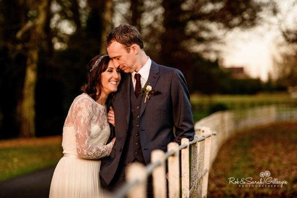 Bride and groom in Brockencote Hall grounds