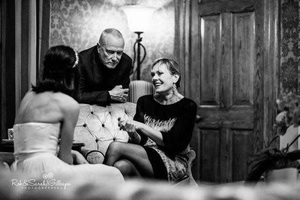 Wedding guests relax at Brockencote Hall