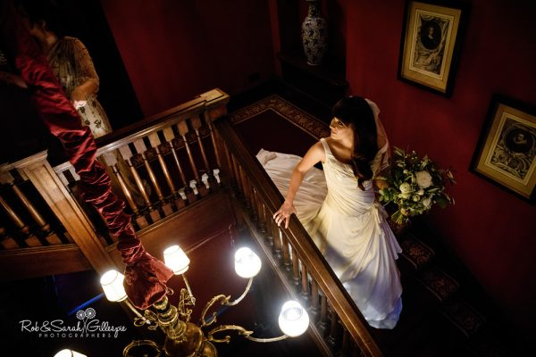 Bride on staircase at Coombe Abbey