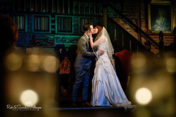 Couple kiss during wedding ceremony at Coombe Abbey