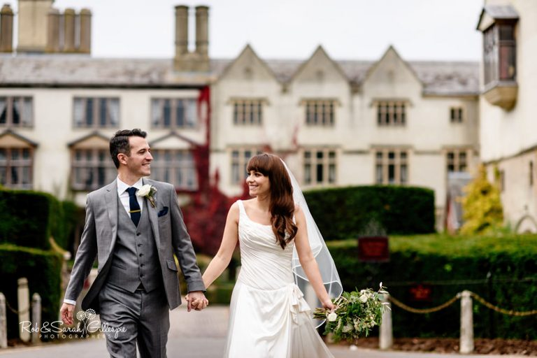 Bride and groom in grounds at Coombe Abbey