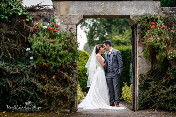 Bride and groom in gardens at Coombe Abbey