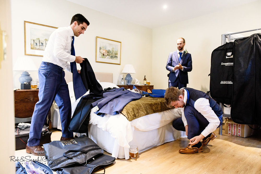 Groom and ushers prepare for wedding at Delbury Hall