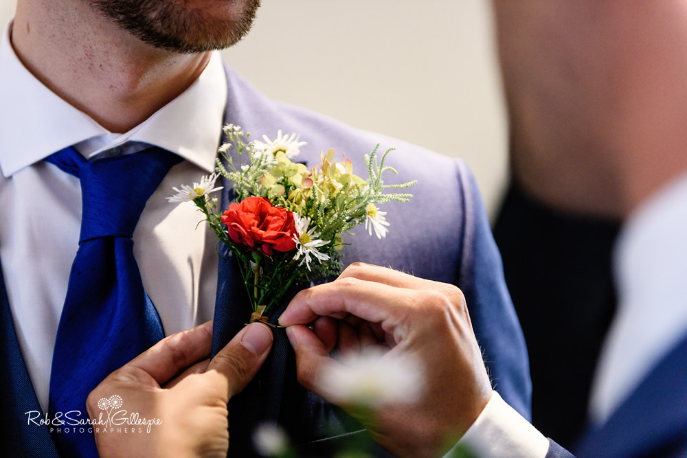 Fixing flower buttonhole to jacket