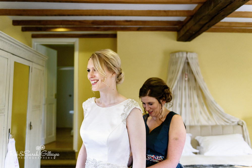 Bride and bridesmaids get ready for wedding at Delbury Hall Coach House