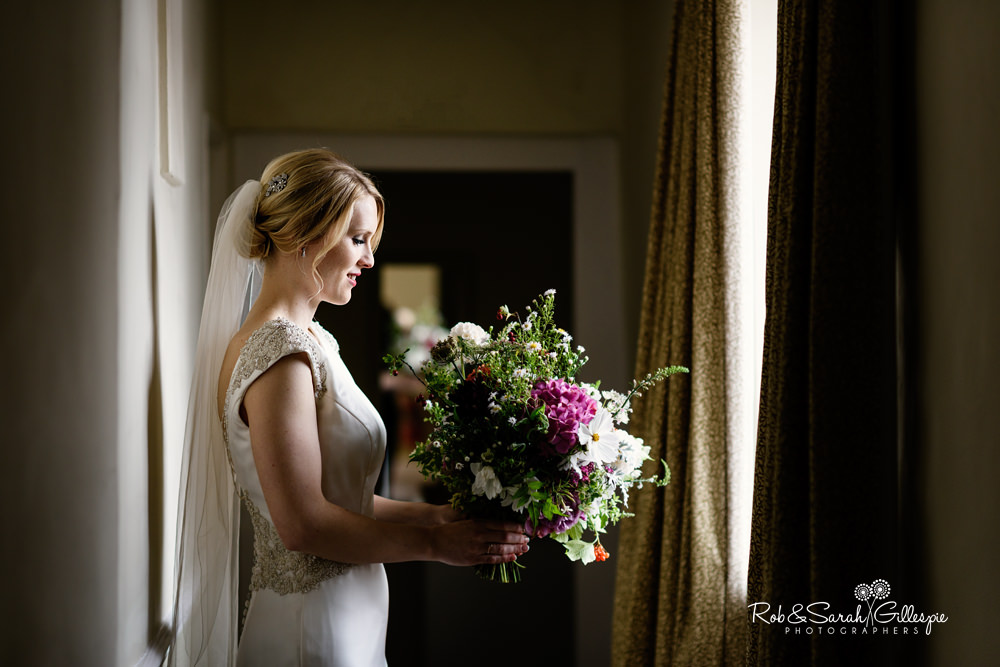 Portrait of bride in window light at Delbury Hall Coach House