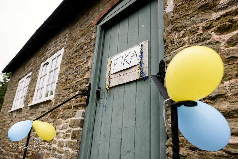 Sign on church hall door reading 'fika' - Swedish word meaning to have coffee with pastries