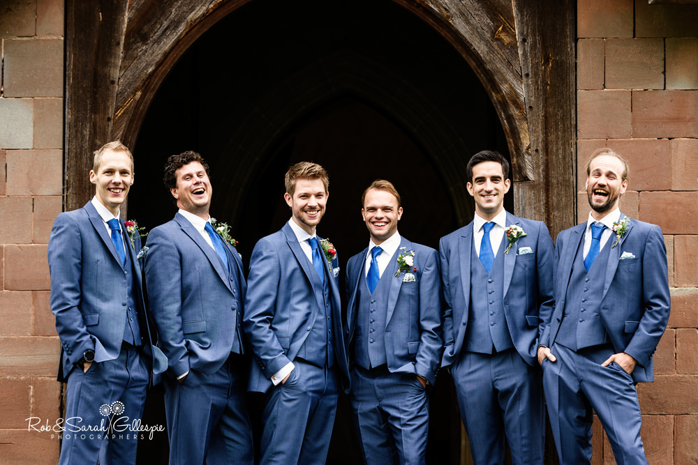 Groom and ushers group photo at St Peter's church Diddlebury