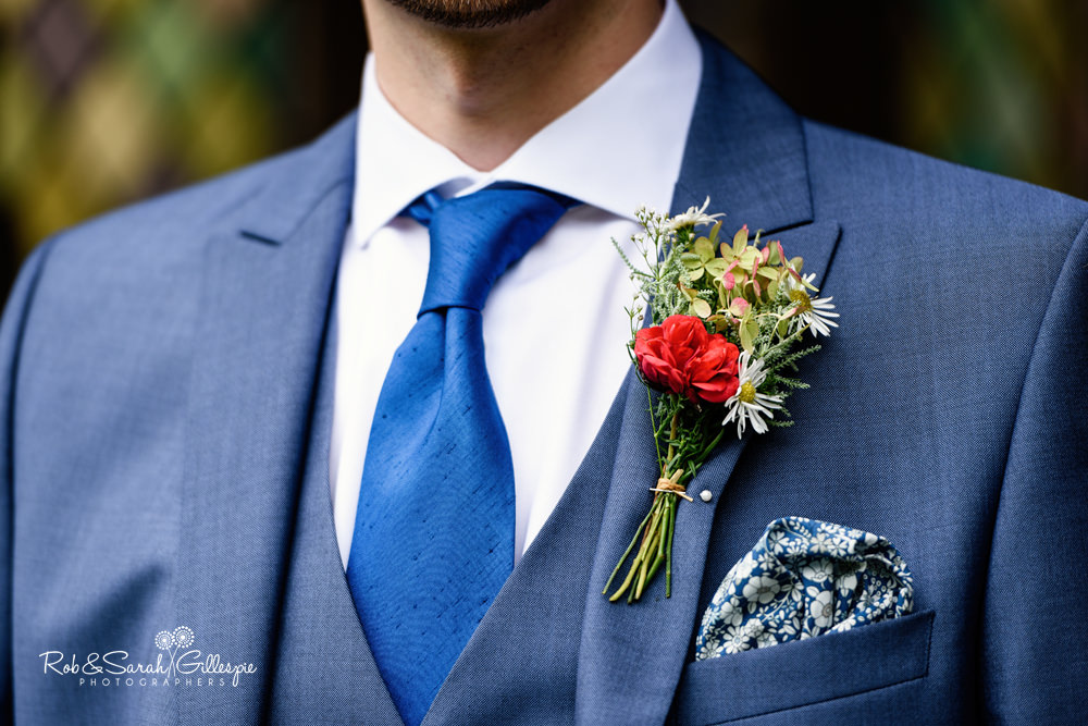 Close-up of groom's buttonhole flower