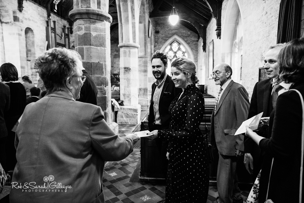 Wedding guests arrive at St Peter's Diddlebury