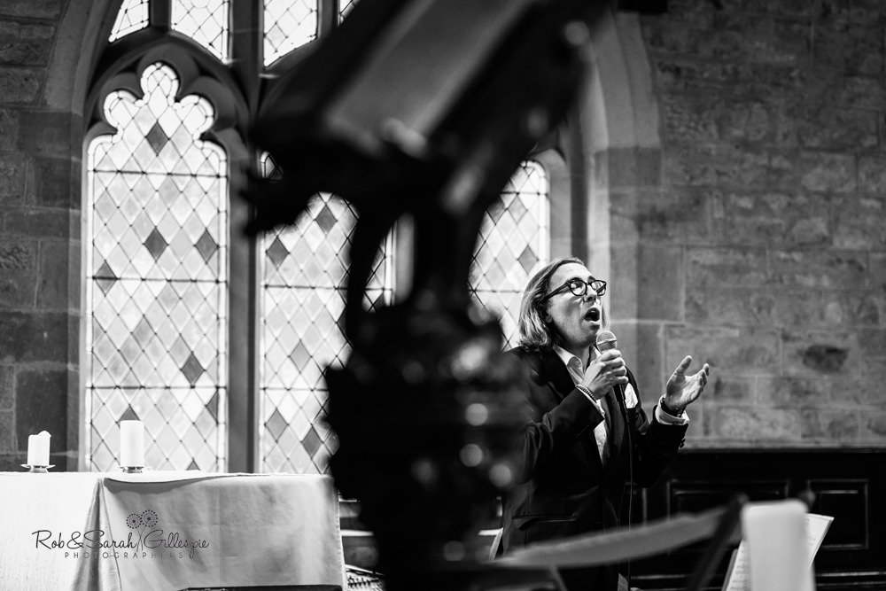 Wedding guests sings during service at St Peter's church Diddlebury