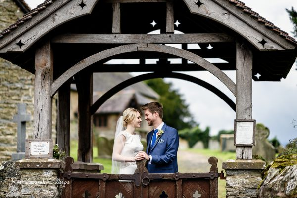 Bride and groom at St Peter's lychgate near Delbury Hall